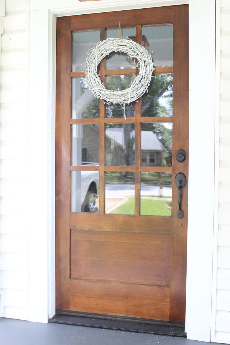 Our new front door dark stained wood with white the for Wood front entry doors